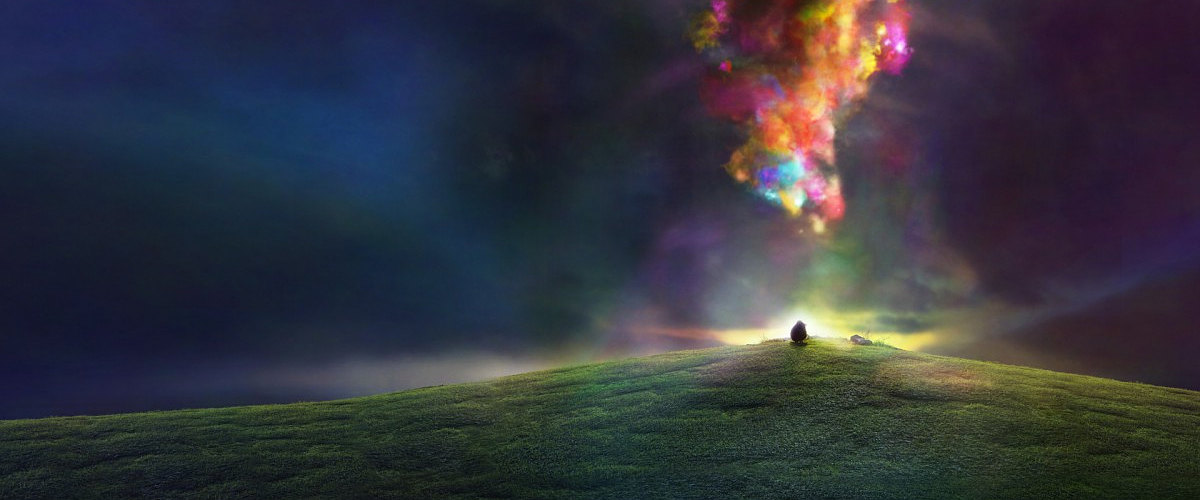A colorful whirwind above a grassy field with a black sheep standing on it.